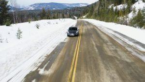 Car on snowy highway